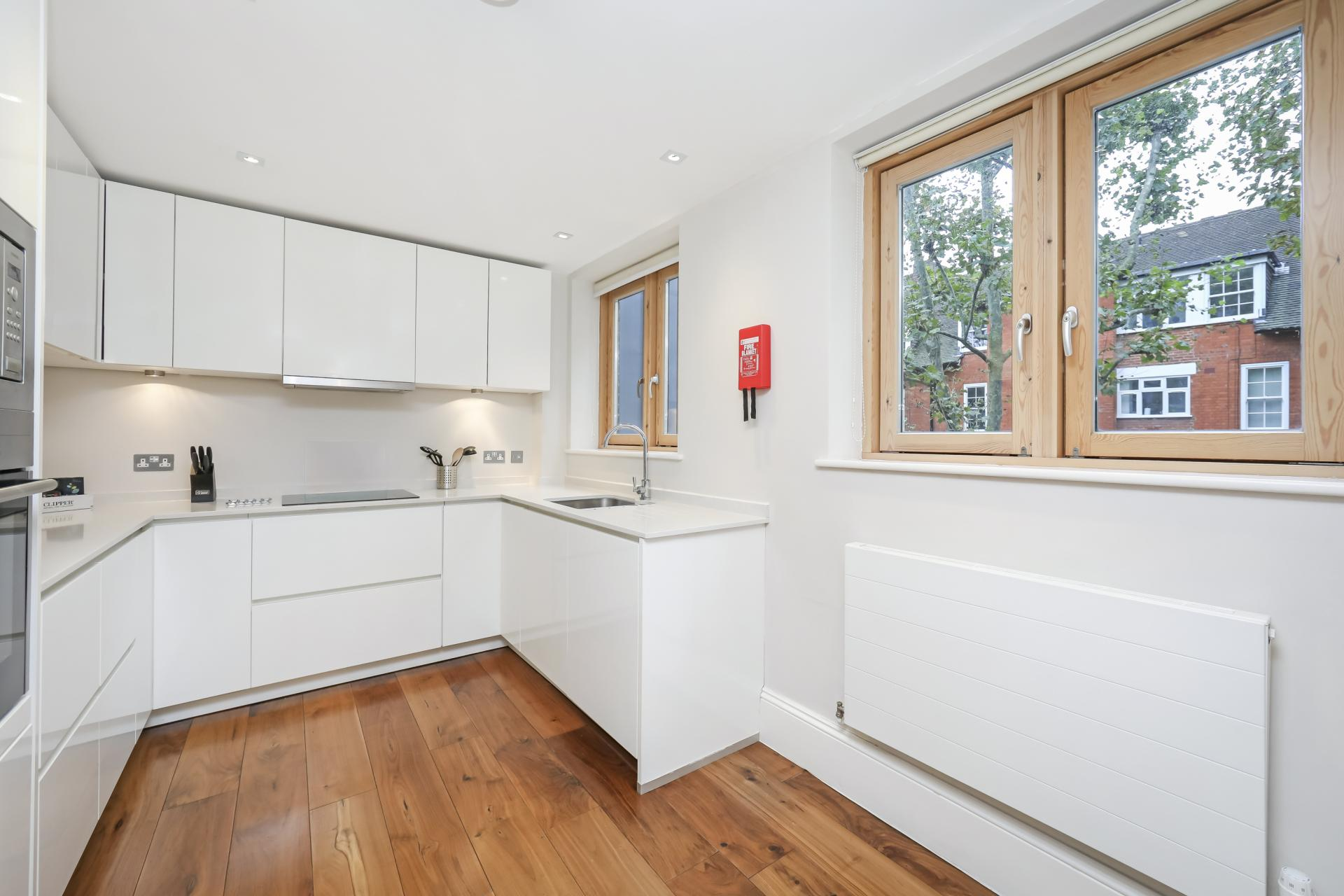 Sleek kitchen at Tavistock Place Apartments, Fitzrovia, London - Citybase Apartments