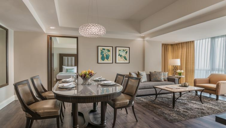 Living area at Somerset Millennium Apartments - Citybase Apartments