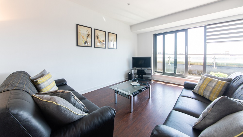 Living room at The Spires Glasgow - Citybase Apartments