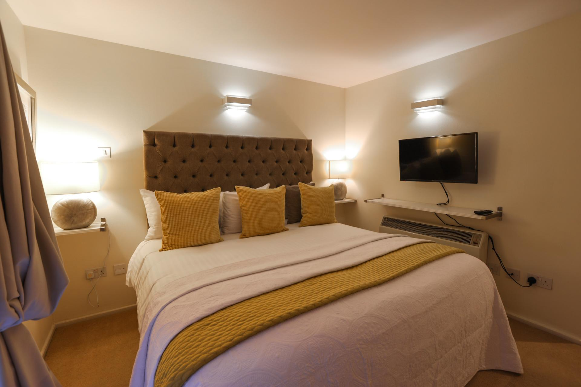 Cosy bedroom at 116 Point West Apartments, South Kensington, London - Citybase Apartments
