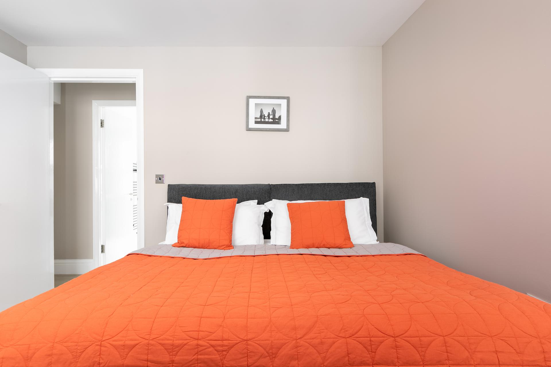 Orange bed at Western Road Apartments, Centre, Brighton - Citybase Apartments