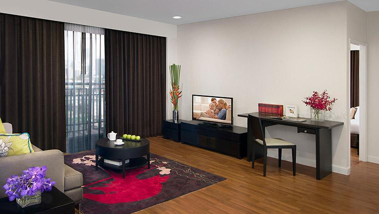 Living area at Somerset Park Suanplu Apartments - Citybase Apartments