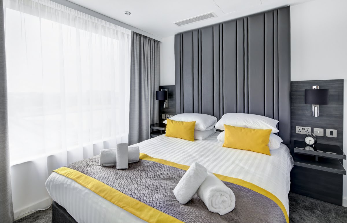 Queen bed at ExCel Dockside Apartments, Royal Docks, London - Citybase Apartments
