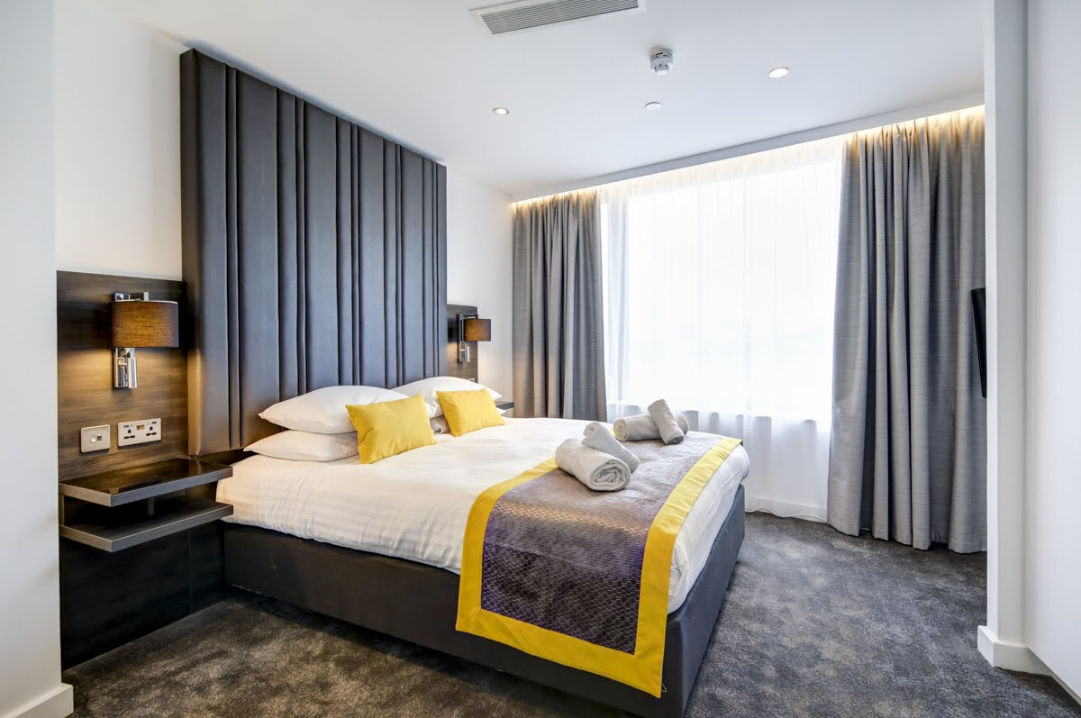 Bright bedroom at ExCel Dockside Apartments, Royal Docks, London - Citybase Apartments