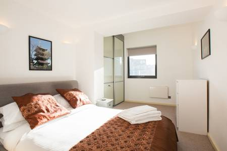 Bronze bedspread at Marzell House Serviced Apartments, West Kensington, London - Citybase Apartments