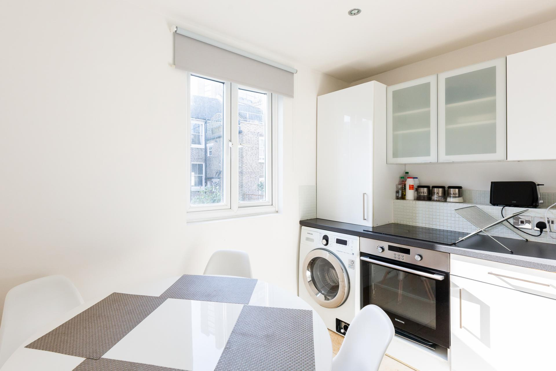 Kitchen diner at ZO Notting Hill Apartments, Maida Vale, London - Citybase Apartments