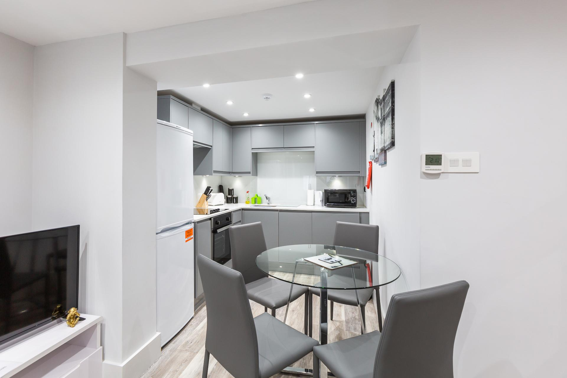 Kitchen at Harrow Road Apartments, Westbourne Green, London - Citybase Apartments