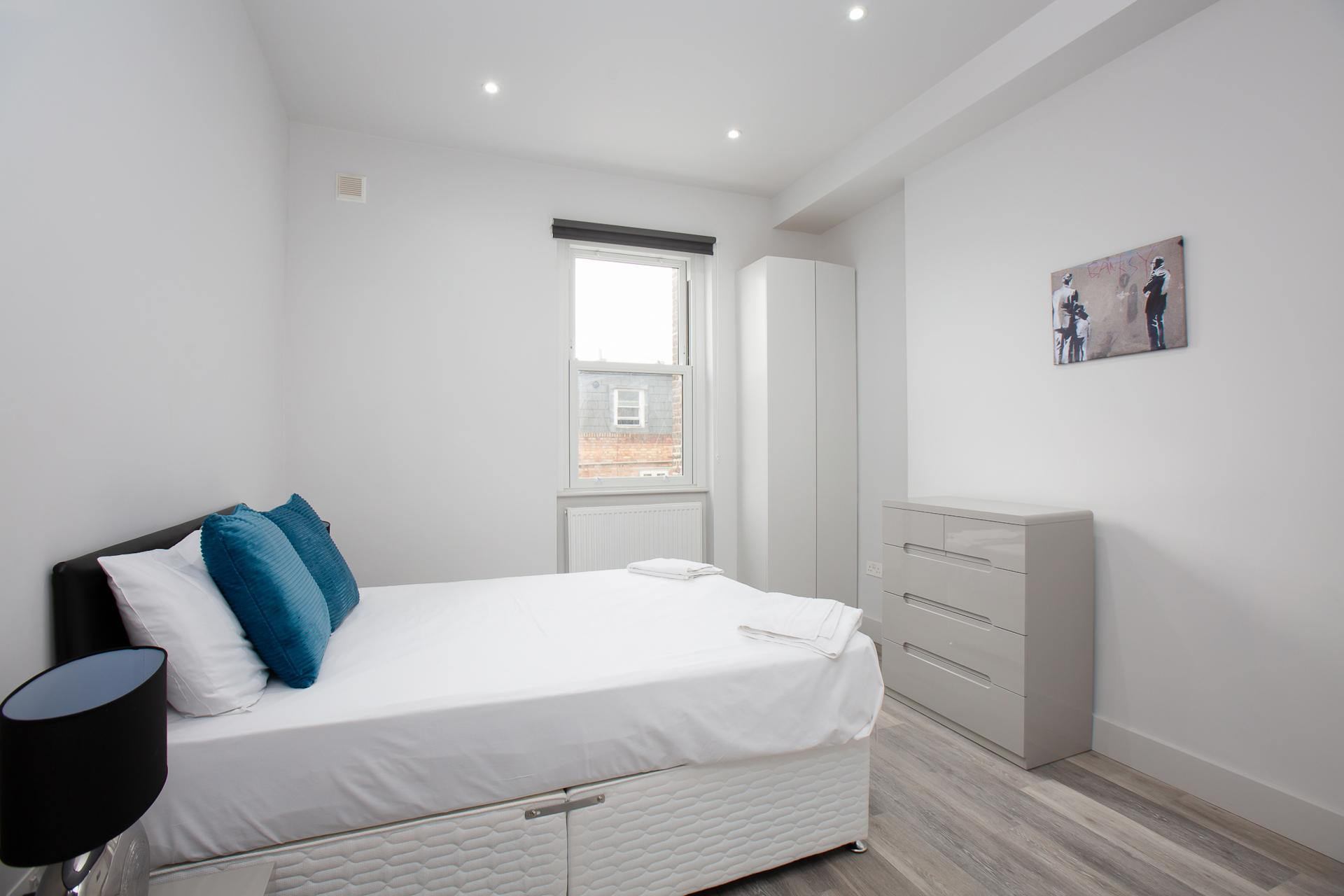 Bedroom at Harrow Road Apartments, Westbourne Green, London - Citybase Apartments