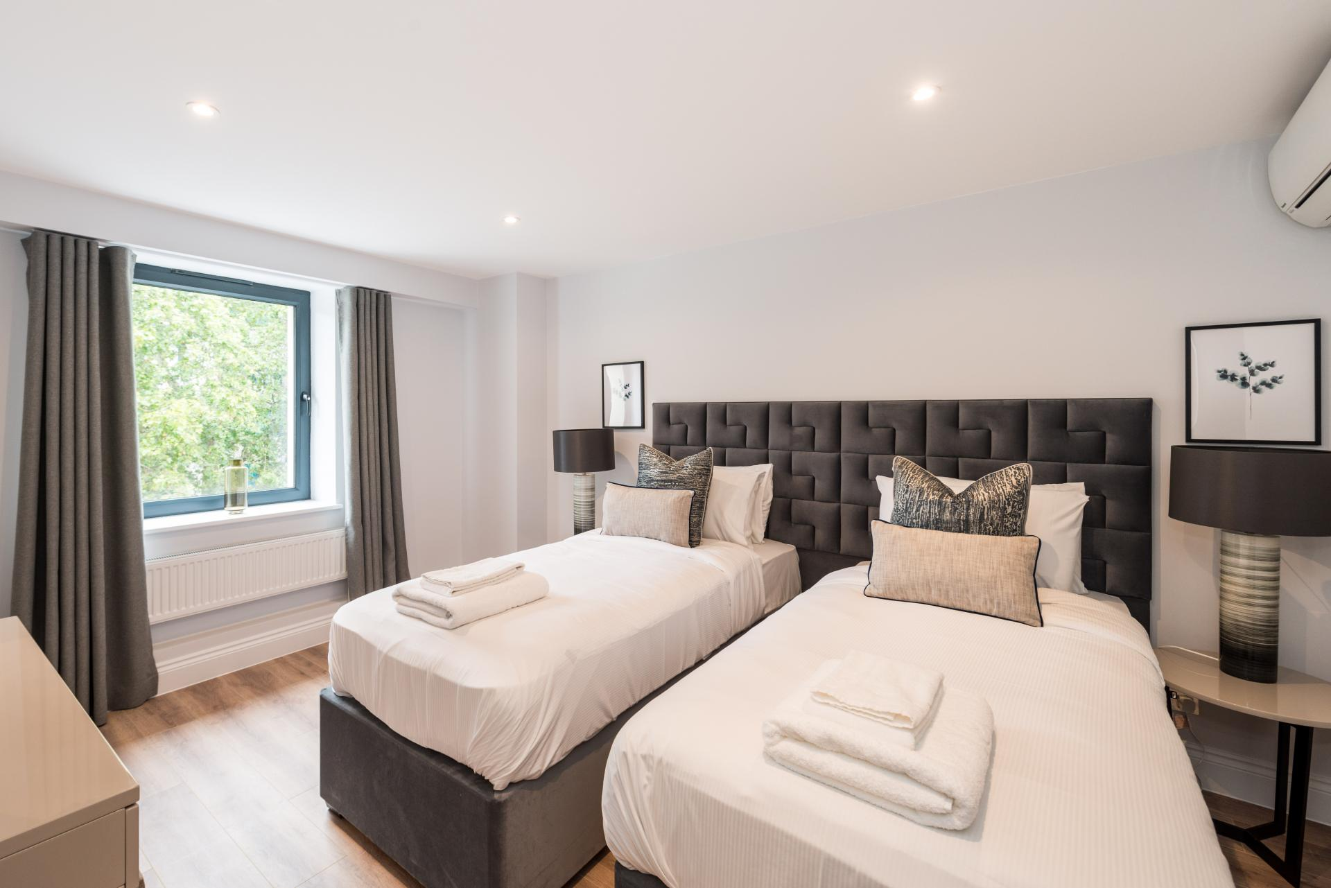 Bed at The Carlyle Serviced Apartments, Earls Court, London - Citybase Apartments