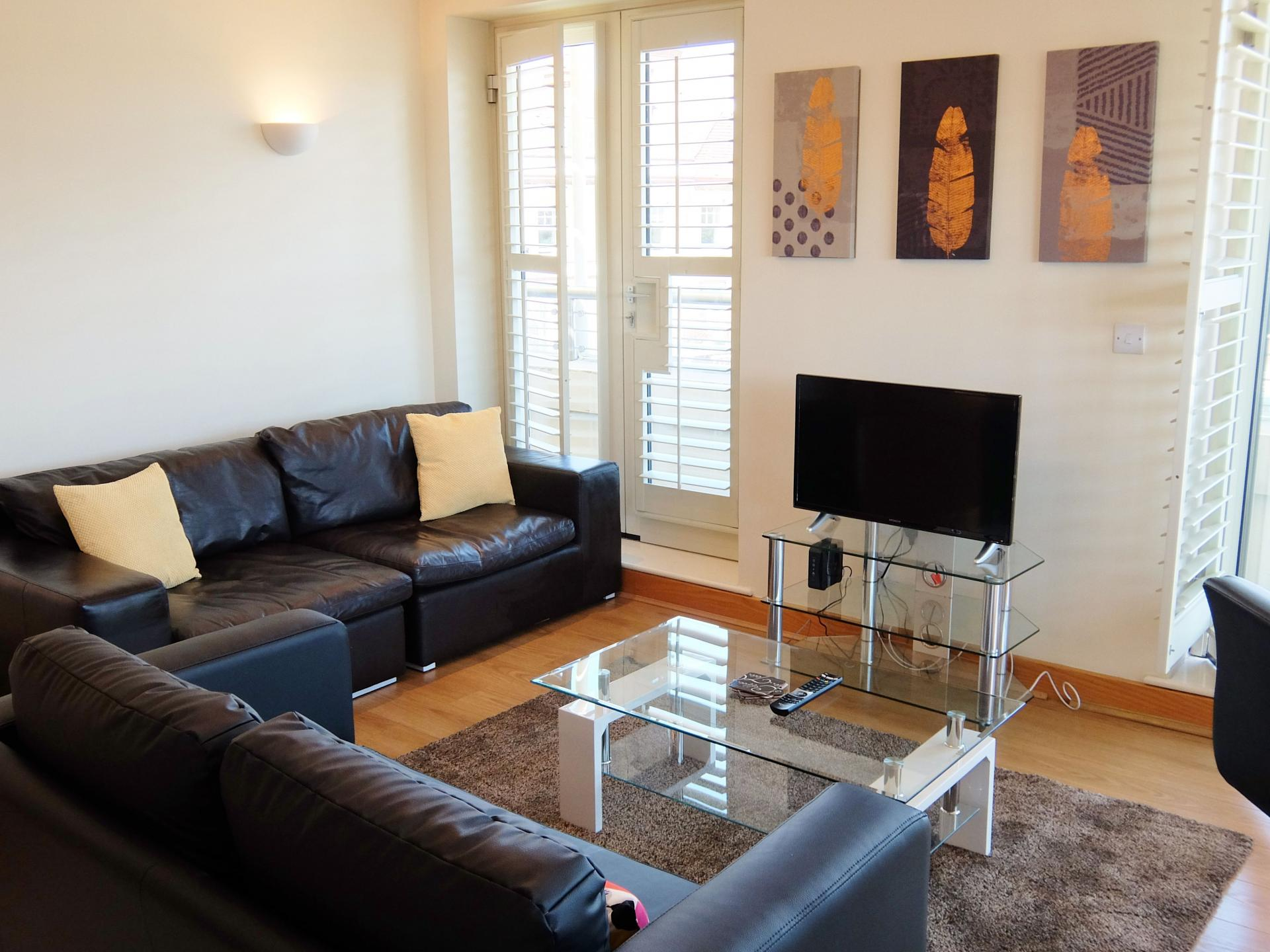 Living area at Hampton Court Creek Road Apartments, Hampton Court, London - Citybase Apartments