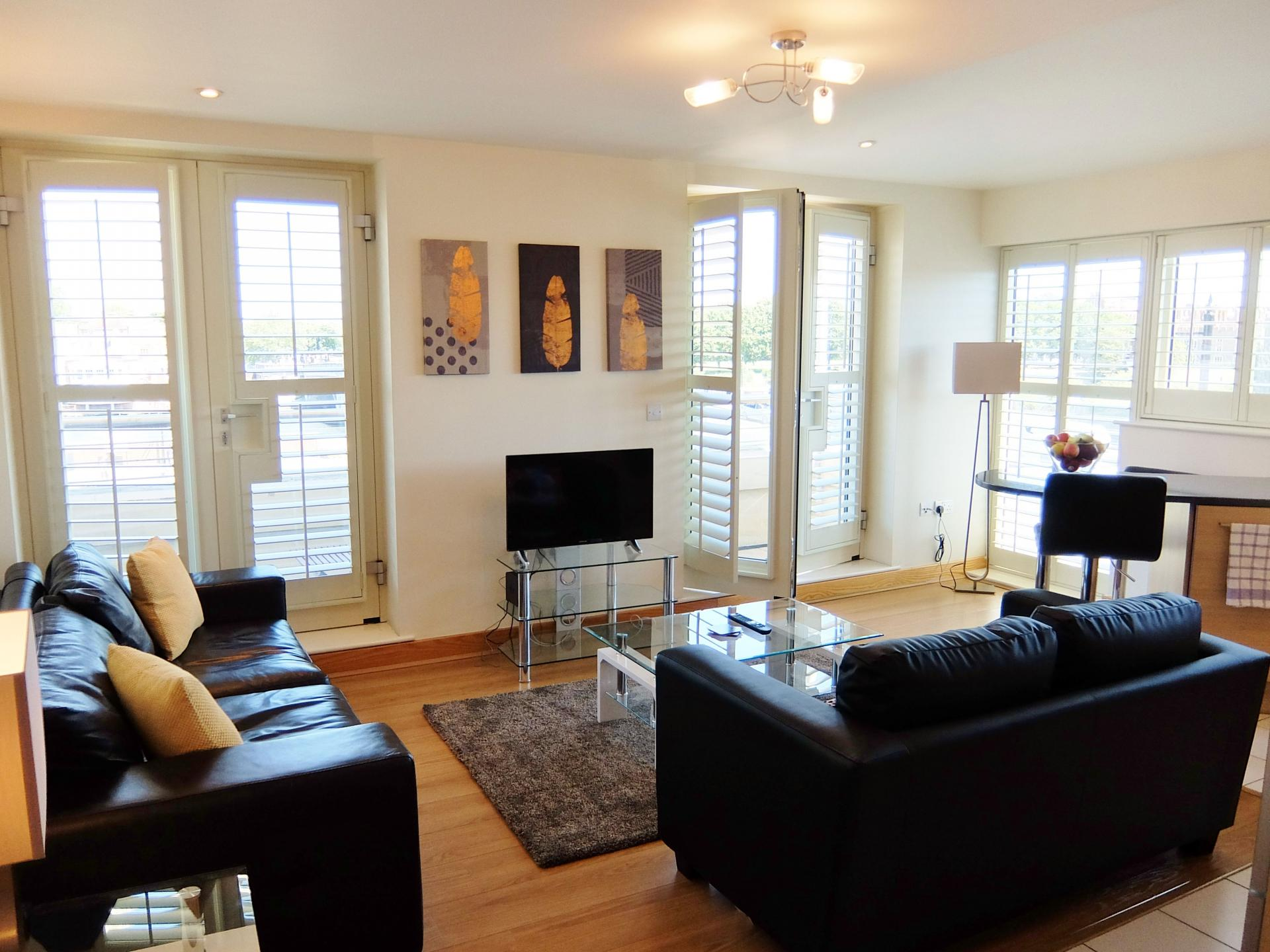 Sofas at Hampton Court Creek Road Apartments - Citybase Apartments