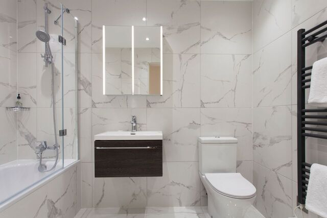 Modern bathroom at Brixham Court Apartments by Charles Hope - Citybase Apartments