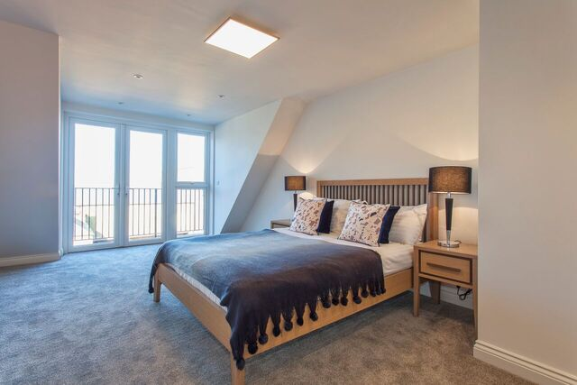 Bright bedroom at Brixham Court Apartments by Charles Hope - Citybase Apartments