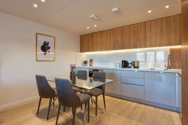 Modern kitchen at Brixham Court Apartments by Charles Hope - Citybase Apartments