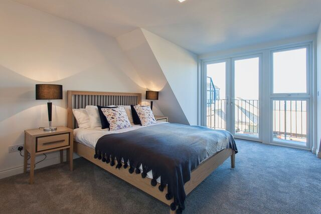 Spacious bedroom at Brixham Court Apartments, Centre, Staines - Citybase Apartments