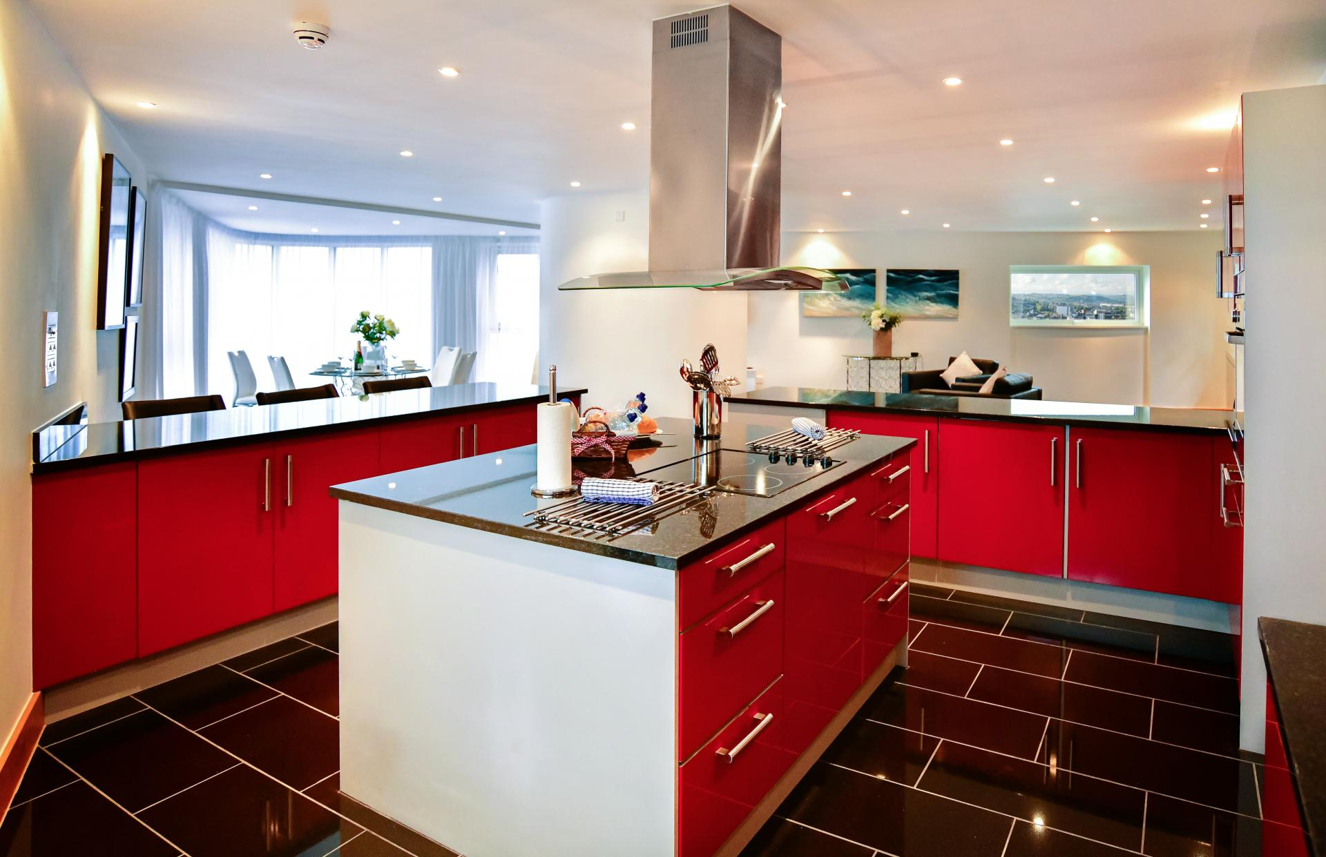 Red kitchen at Meridian Quay Penthouses, Maritime Quarter, Swansea - Citybase Apartments