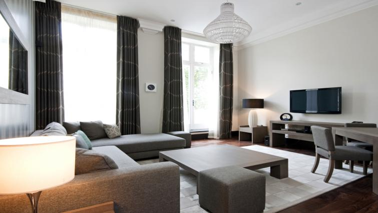 Modern living room at 130 Queens Gate Apartments - Citybase Apartments