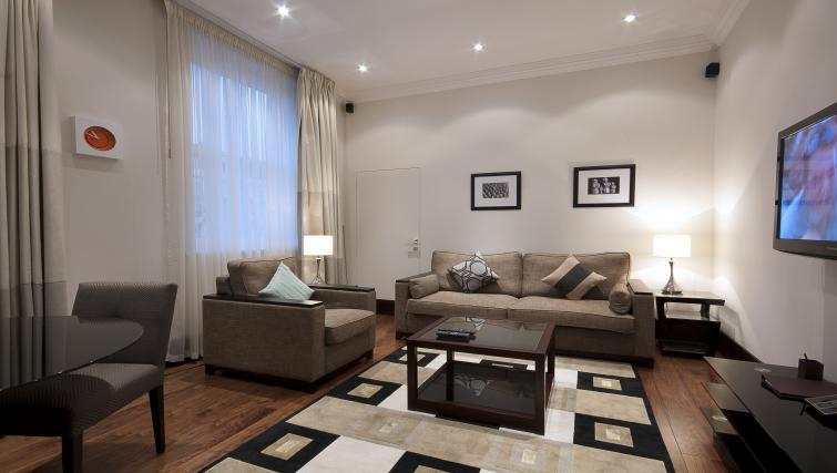 Modern living area at 130 Queens Gate Apartments - Citybase Apartments