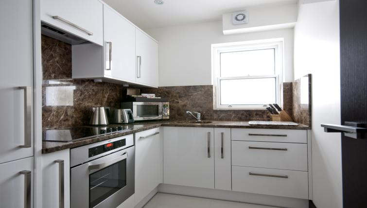 Kitchen at 130 Queens Gate Apartments - Citybase Apartments