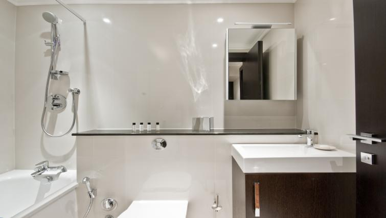 Bathroom in studio at 130 Queens Gate Apartments - Citybase Apartments