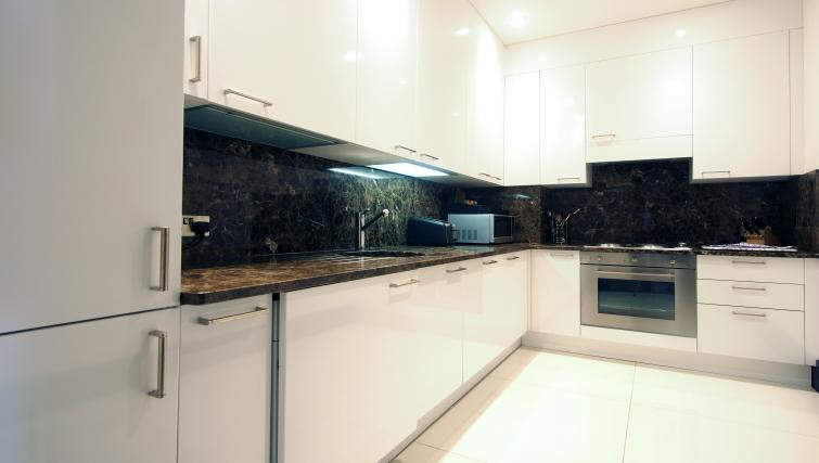 Equipped kitchen at 130 Queens Gate Apartments - Citybase Apartments