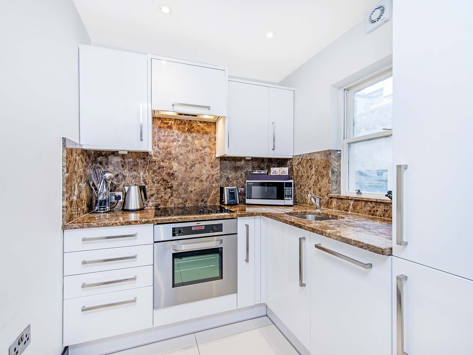 Kitchen at 130 Queens Gate Apartments, South Kensington, London - Citybase Apartments