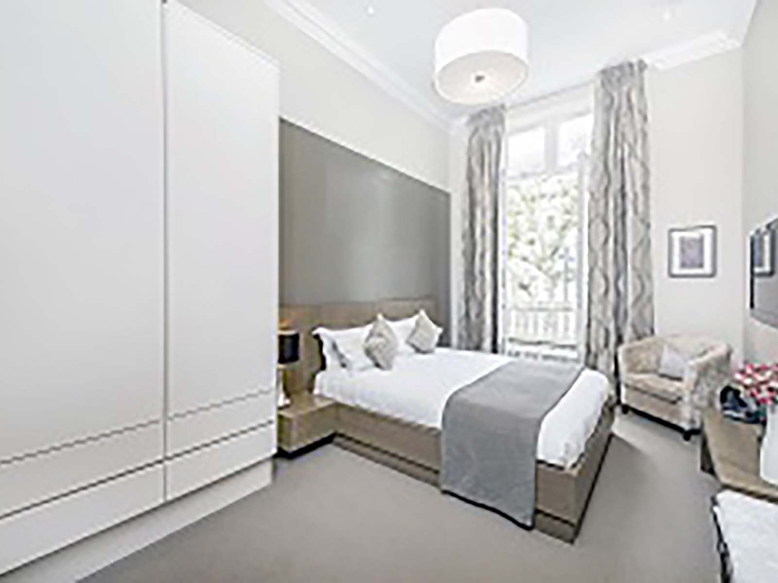 Bedroom at 130 Queens Gate Apartments, South Kensington, London - Citybase Apartments