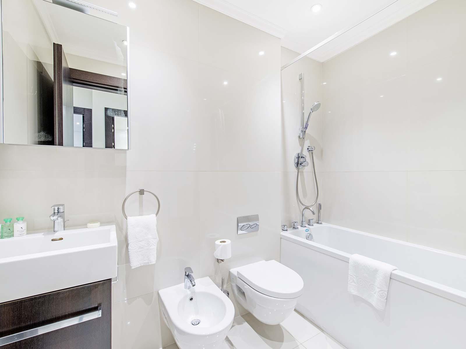 Bath at 130 Queens Gate Apartments, South Kensington, London - Citybase Apartments