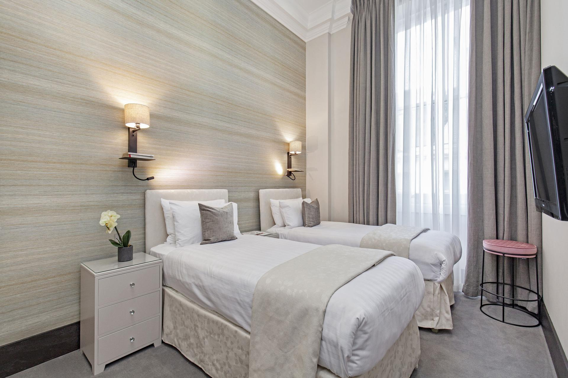 Single beds at 130 Queens Gate Apartments, South Kensington, London - Citybase Apartments