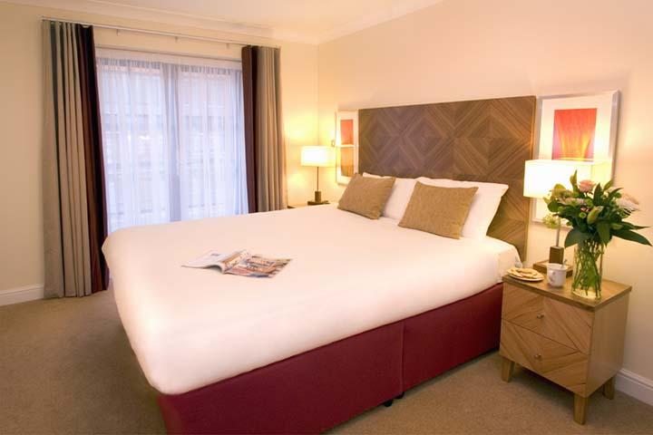 Large bedroom at Premier Suites Bristol Redcliffe Apartments - Citybase Apartments