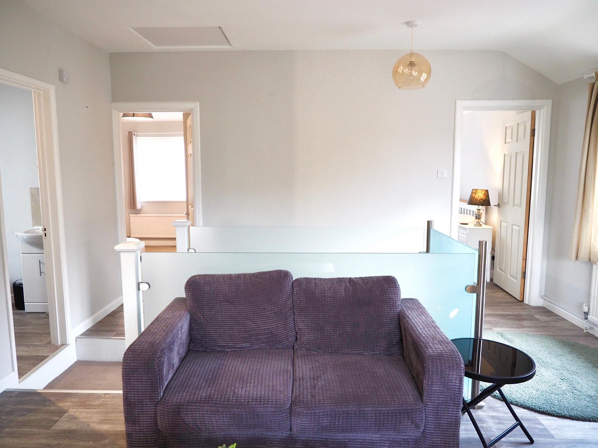 Purple sofa at Exeter Suite Apartments, Headington, Oxford - Citybase Apartments