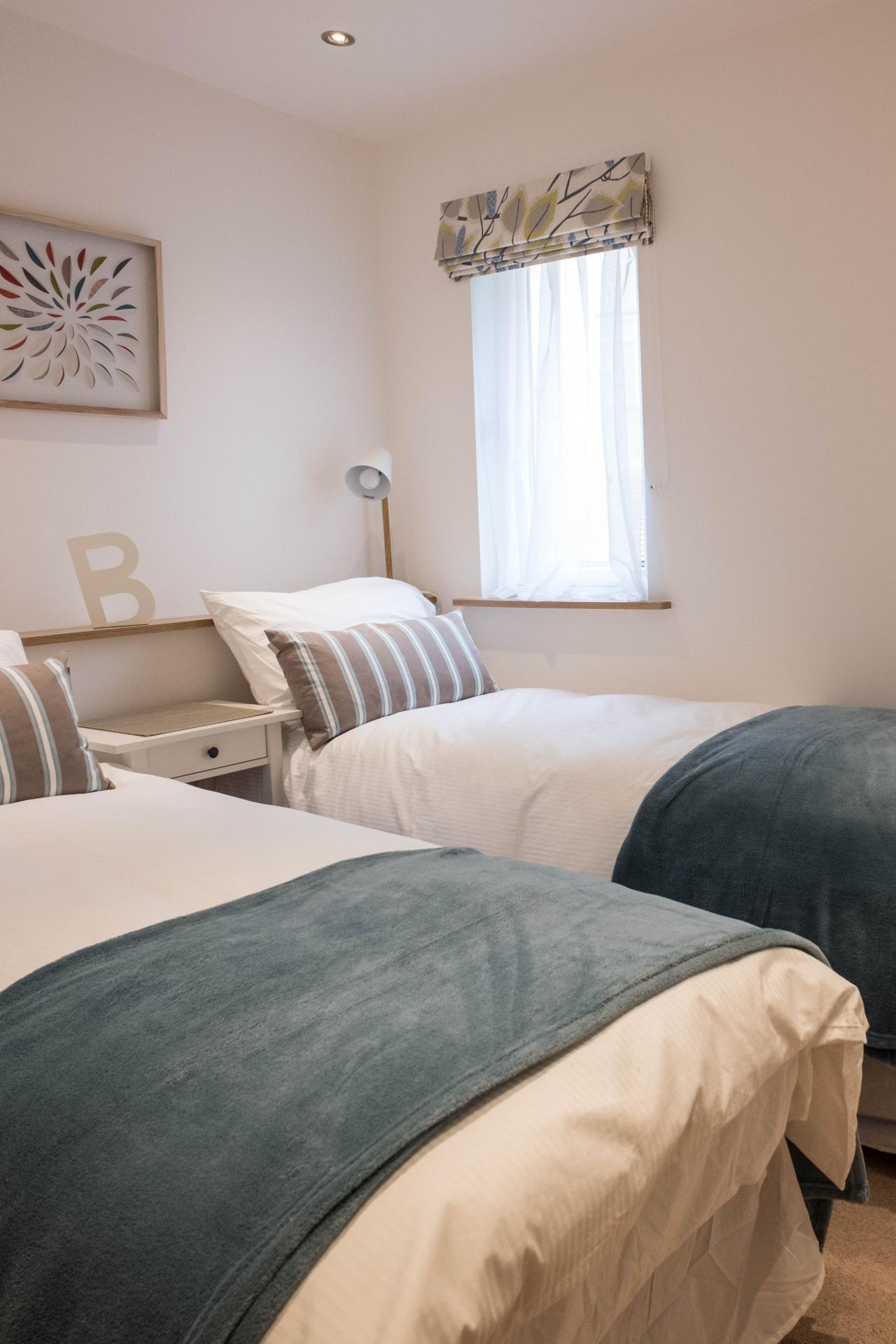 Twin beds at Oakfield Court Apartment Hotel, Sale, Manchester - Citybase Apartments