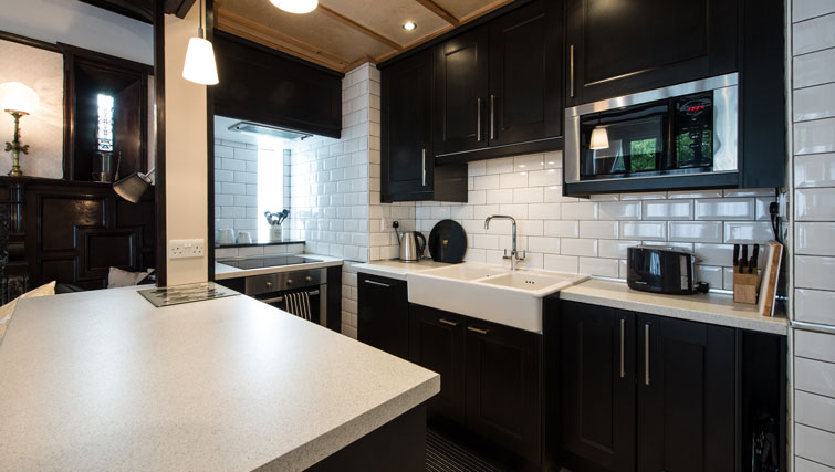 Sleek kitchen at Oakfield Court Apartment Hotel, Sale, Manchester - Citybase Apartments