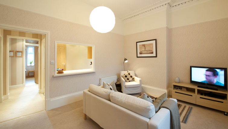 Comfy lounge at Oakfield Court Apartment Hotel, Sale, Manchester - Citybase Apartments