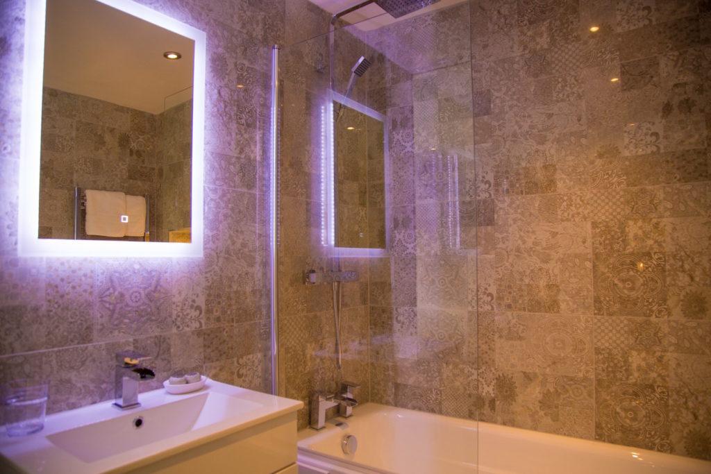 Sleek bathroom at No. 10 Theatre Street, Centre, Preston - Citybase Apartments