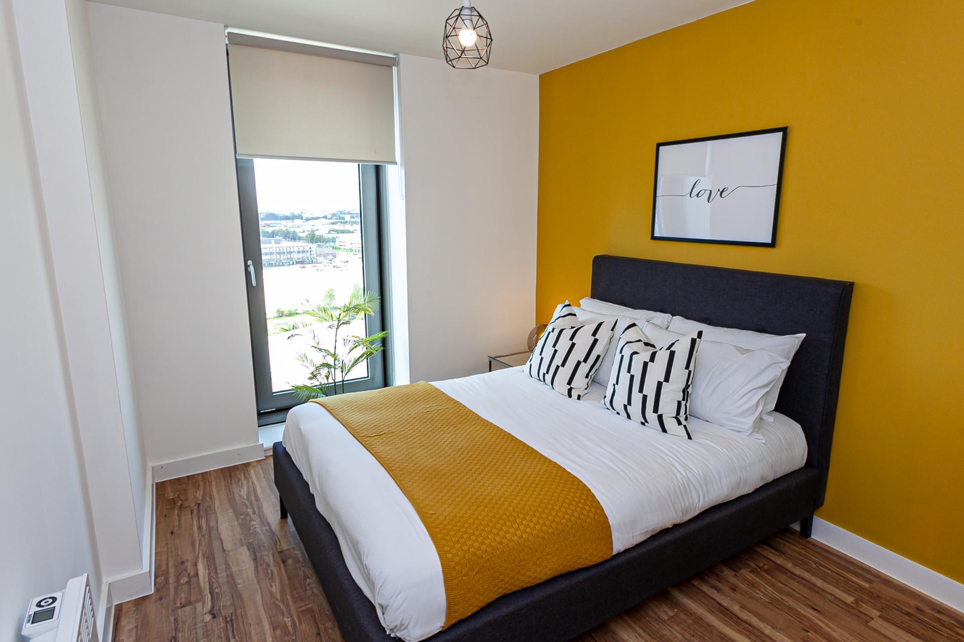 Yellow wall at Michigan Point Tower, Ordsall, Manchester - Citybase Apartments