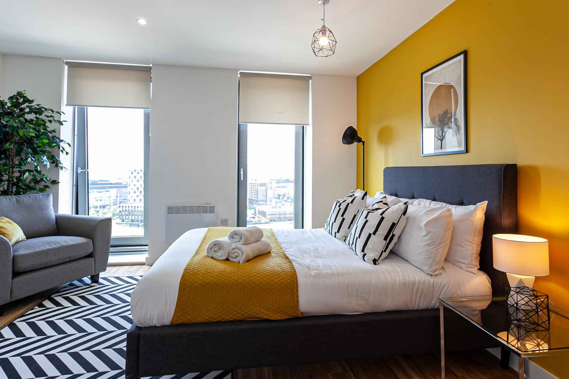 Bright bedroom at Michigan Point Tower, Ordsall, Manchester - Citybase Apartments
