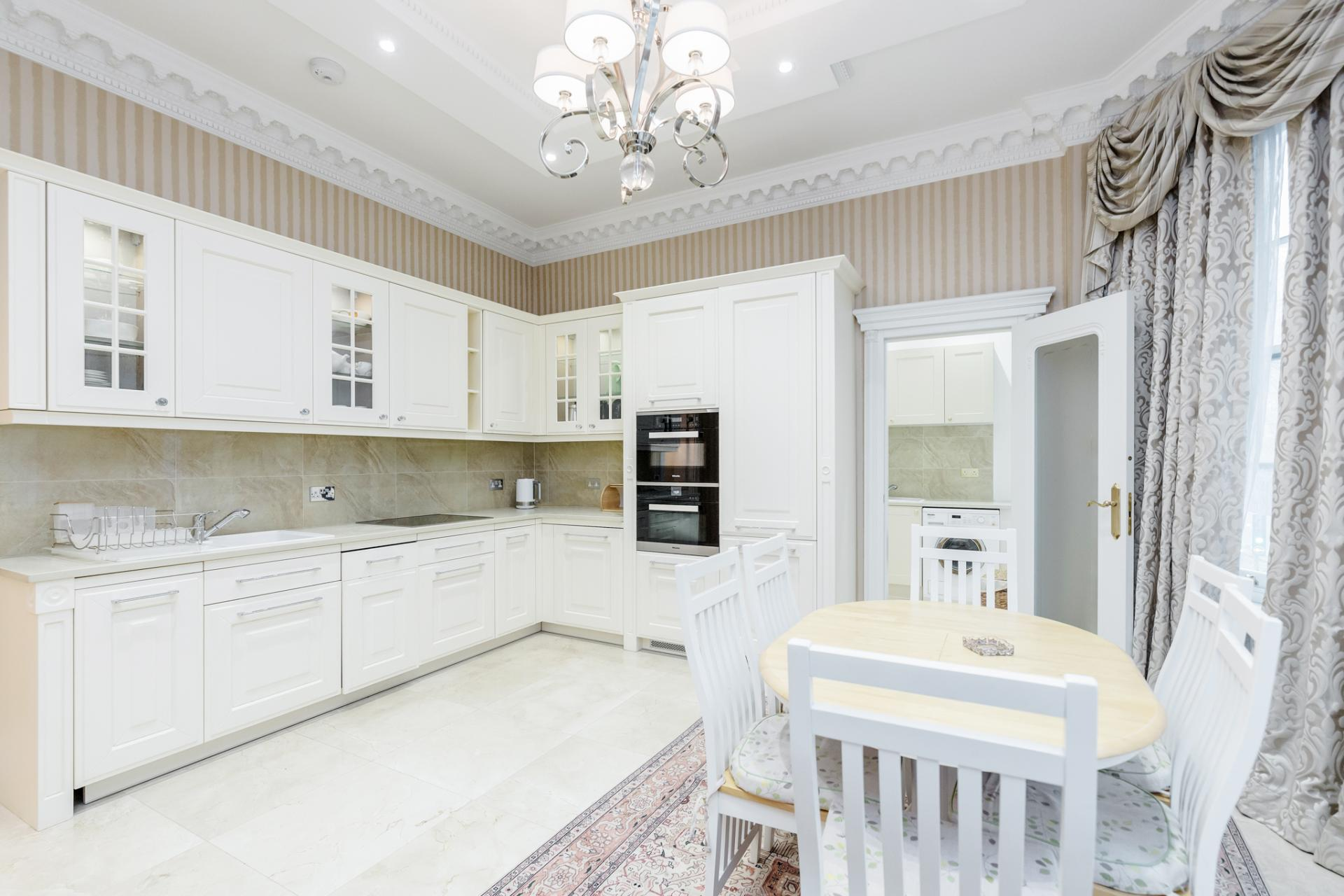 Kitchen at Hallway at Grosvenor Square Apartment, Mayfair, London - Citybase Apartments