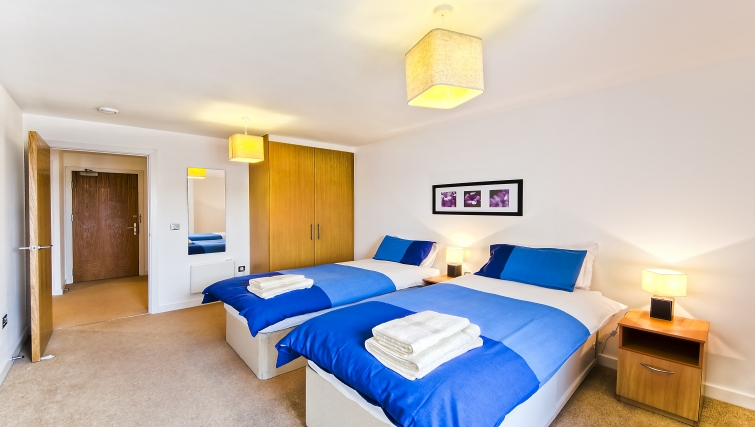Bright bedroom in Armstrong House - Citybase Apartments