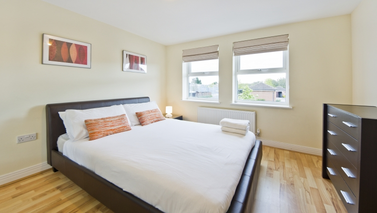 Simplistic bedroom in Woodgate Court Apartments - Citybase Apartments