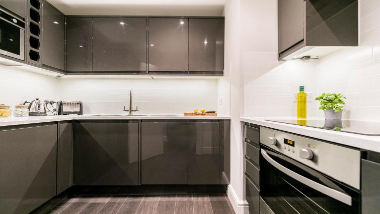 Kitchen area at Native Fenchurch Street Apartments - Citybase Apartments