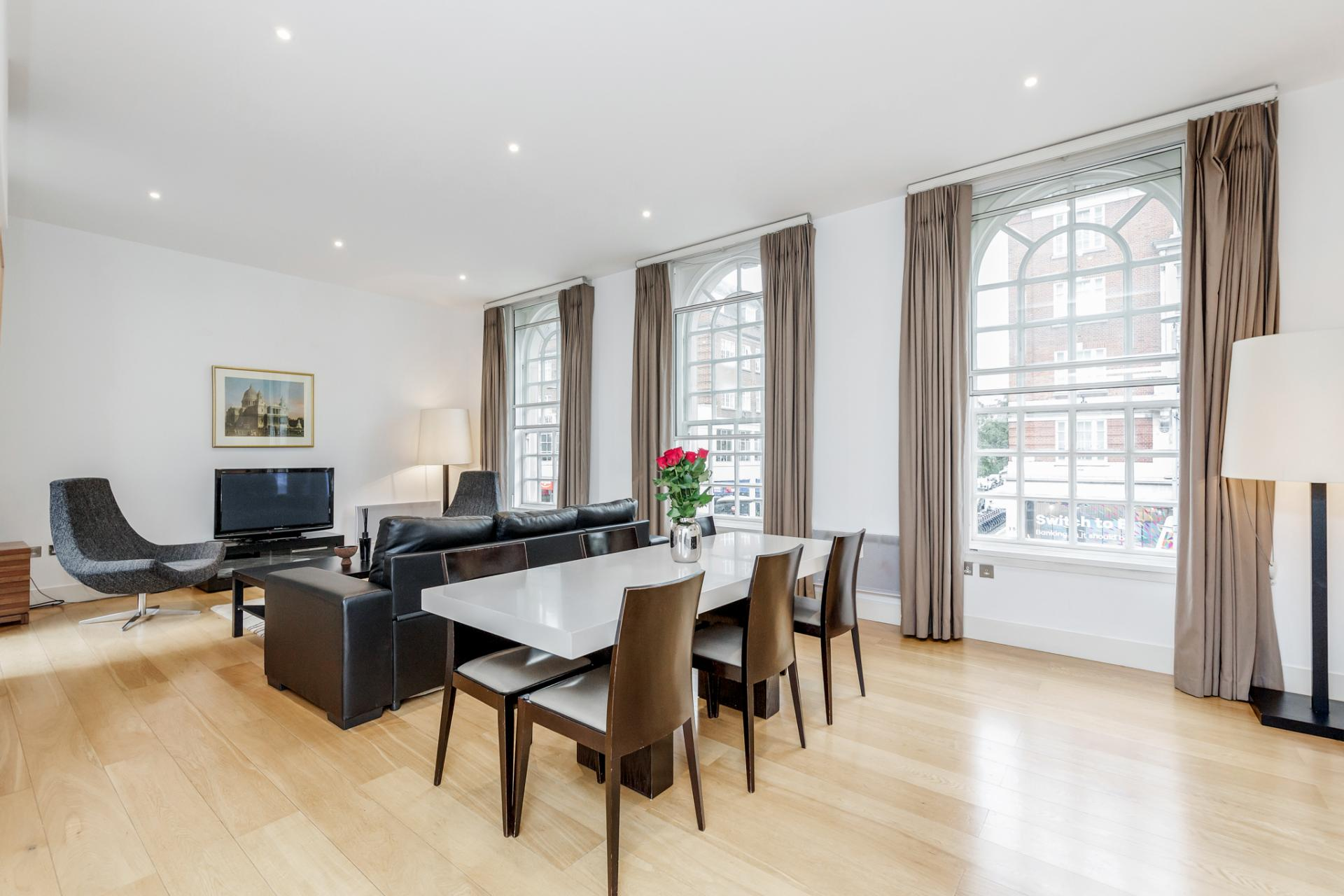 Dining and living areas at Eden Close Apartment, Kensington, London - Citybase Apartments
