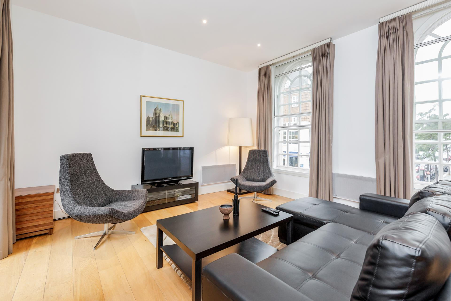 Lounge area at Eden Close Apartment, Kensington, London - Citybase Apartments