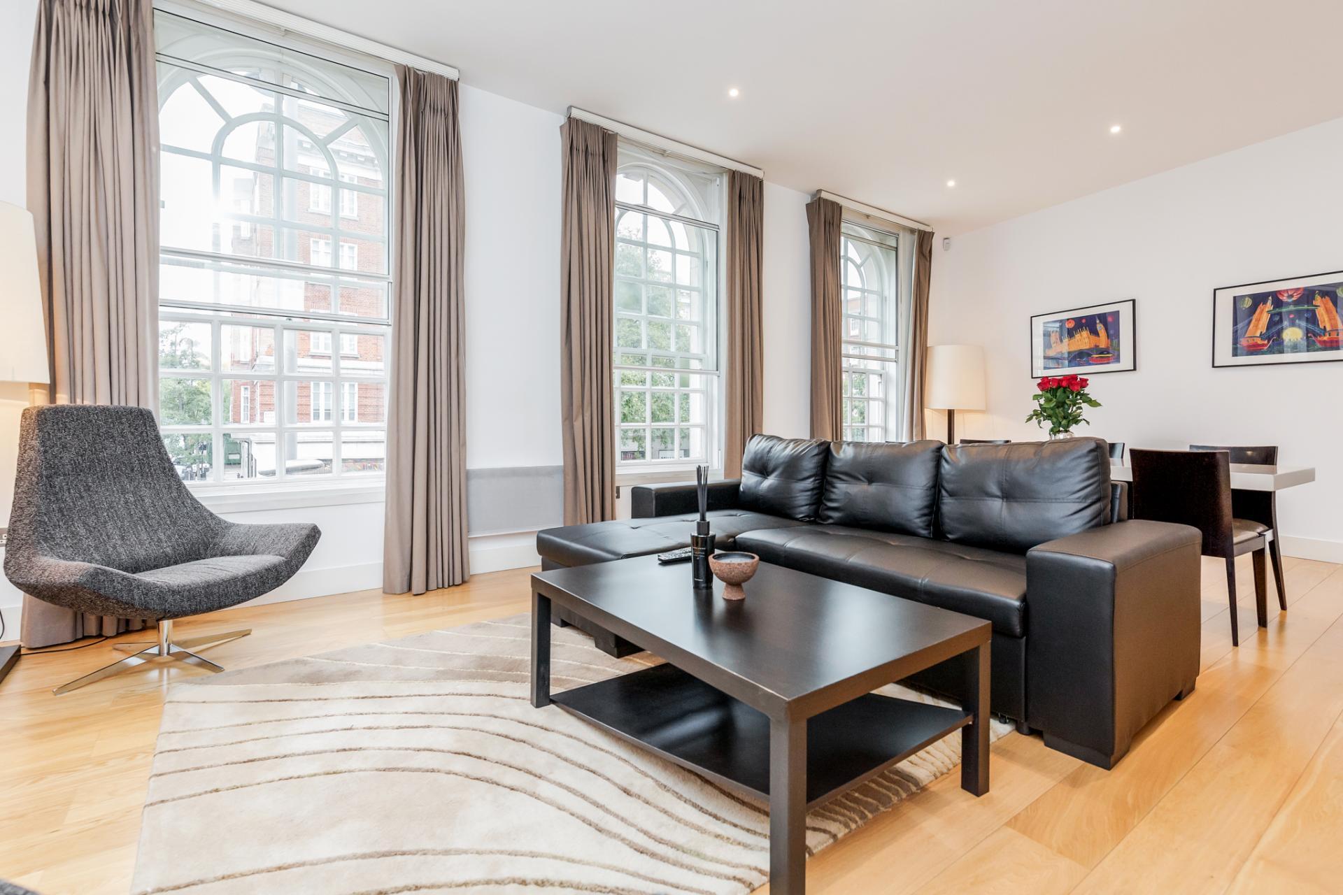Living room at Eden Close Apartment, Kensington, London - Citybase Apartments