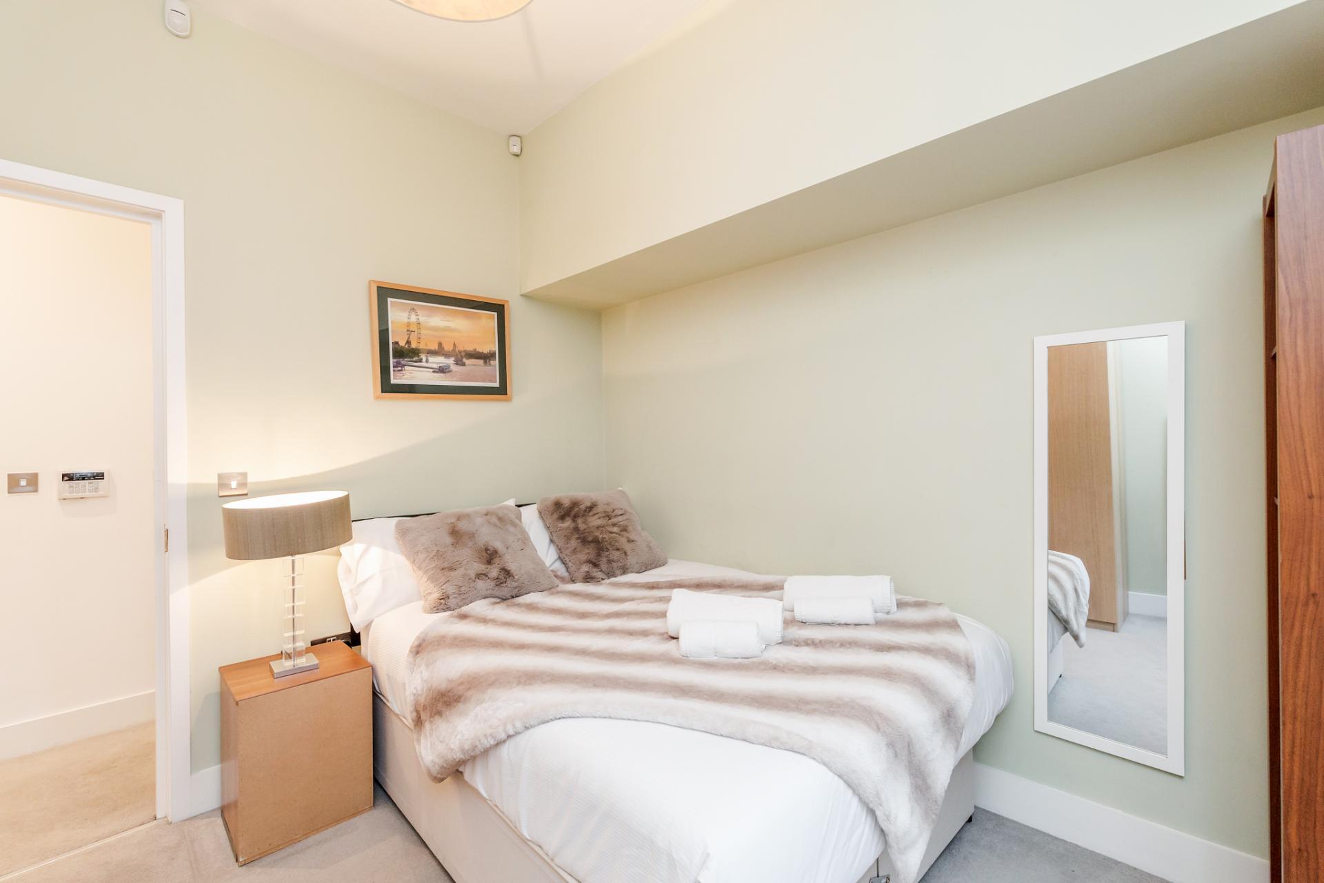 Cosy bed at Eden Close Apartment, Kensington, London - Citybase Apartments