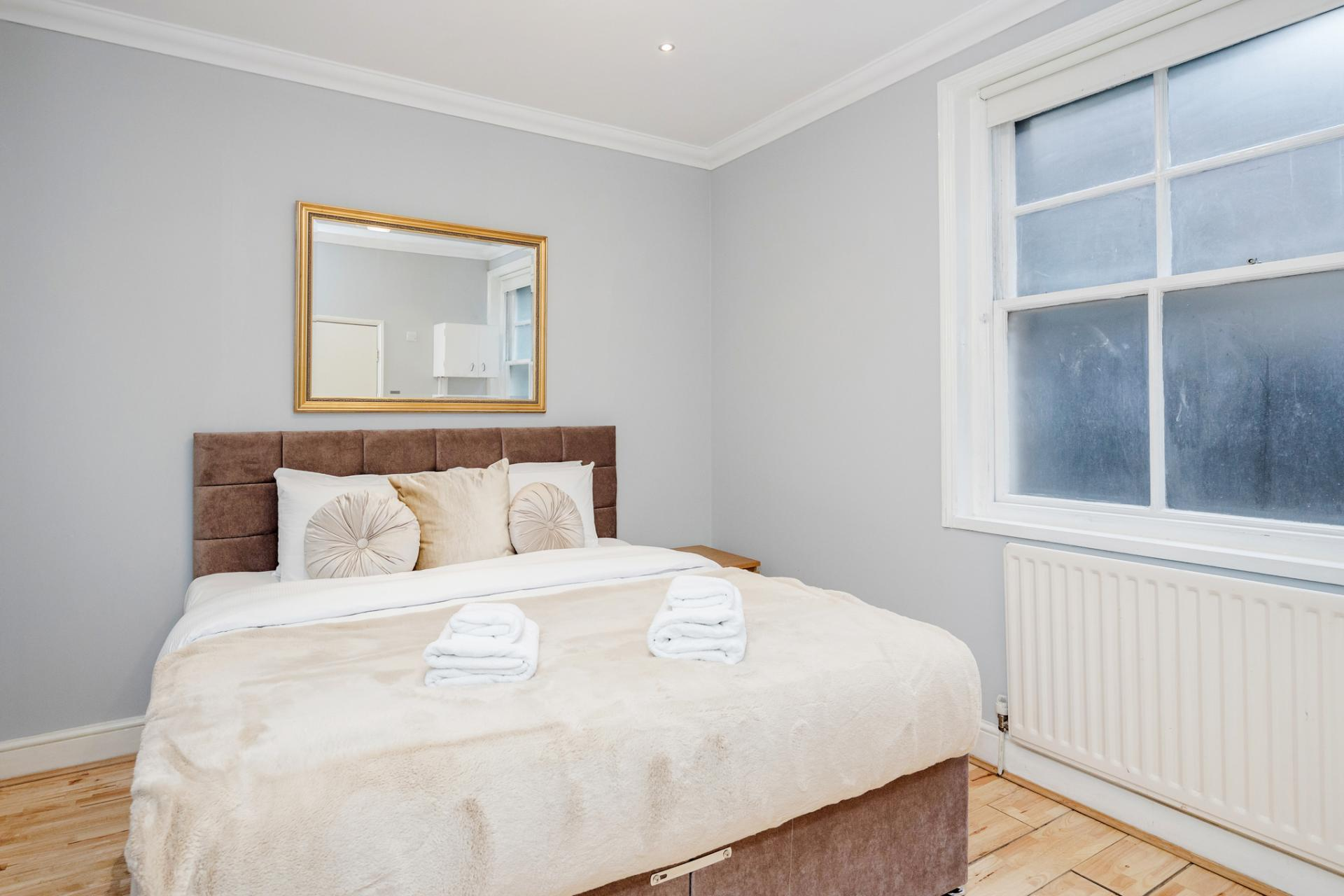 Bed at Kensington High Street, Kensington, London - Citybase Apartments
