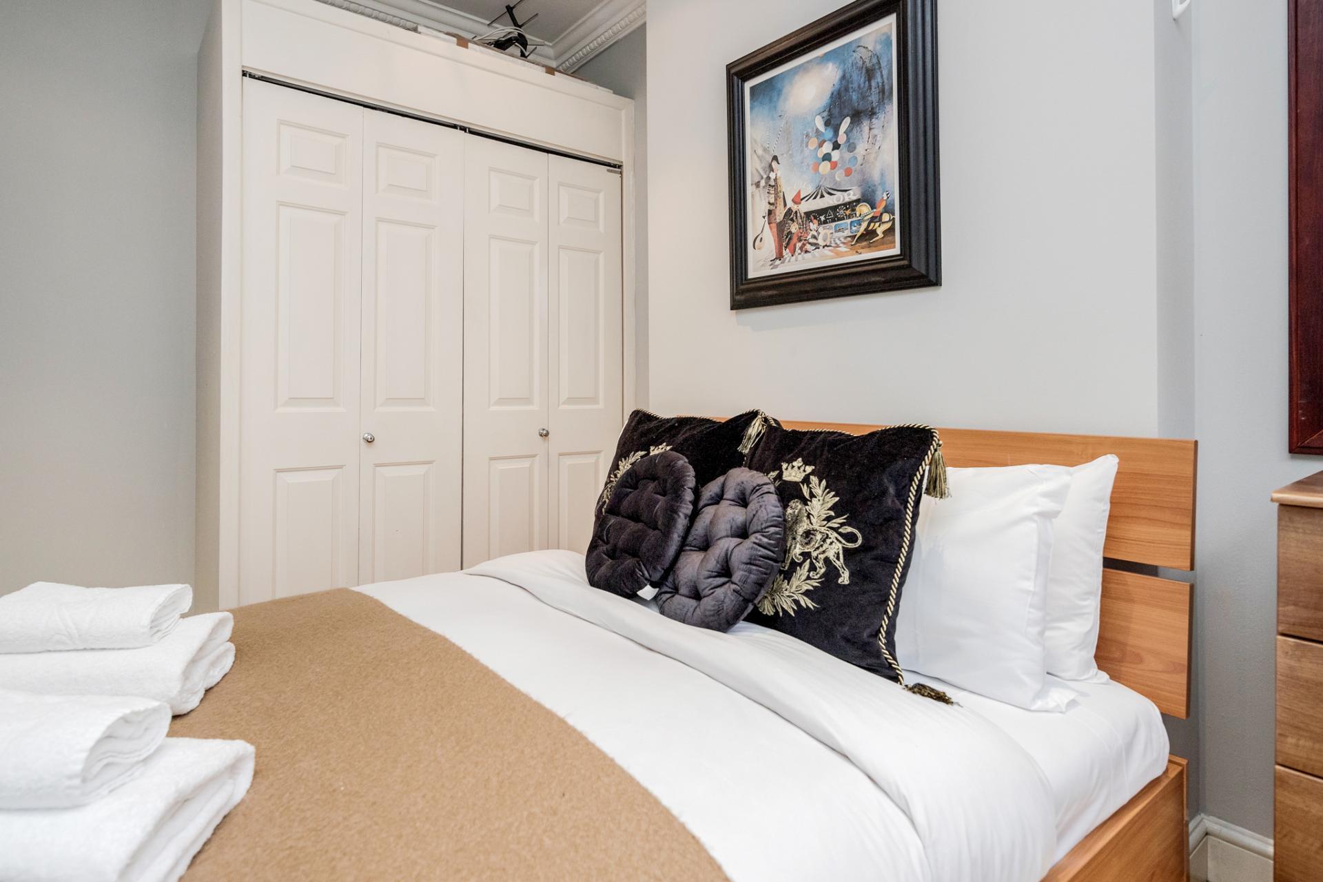 Spacious bedroom at Kensington High Street, Kensington, London - Citybase Apartments