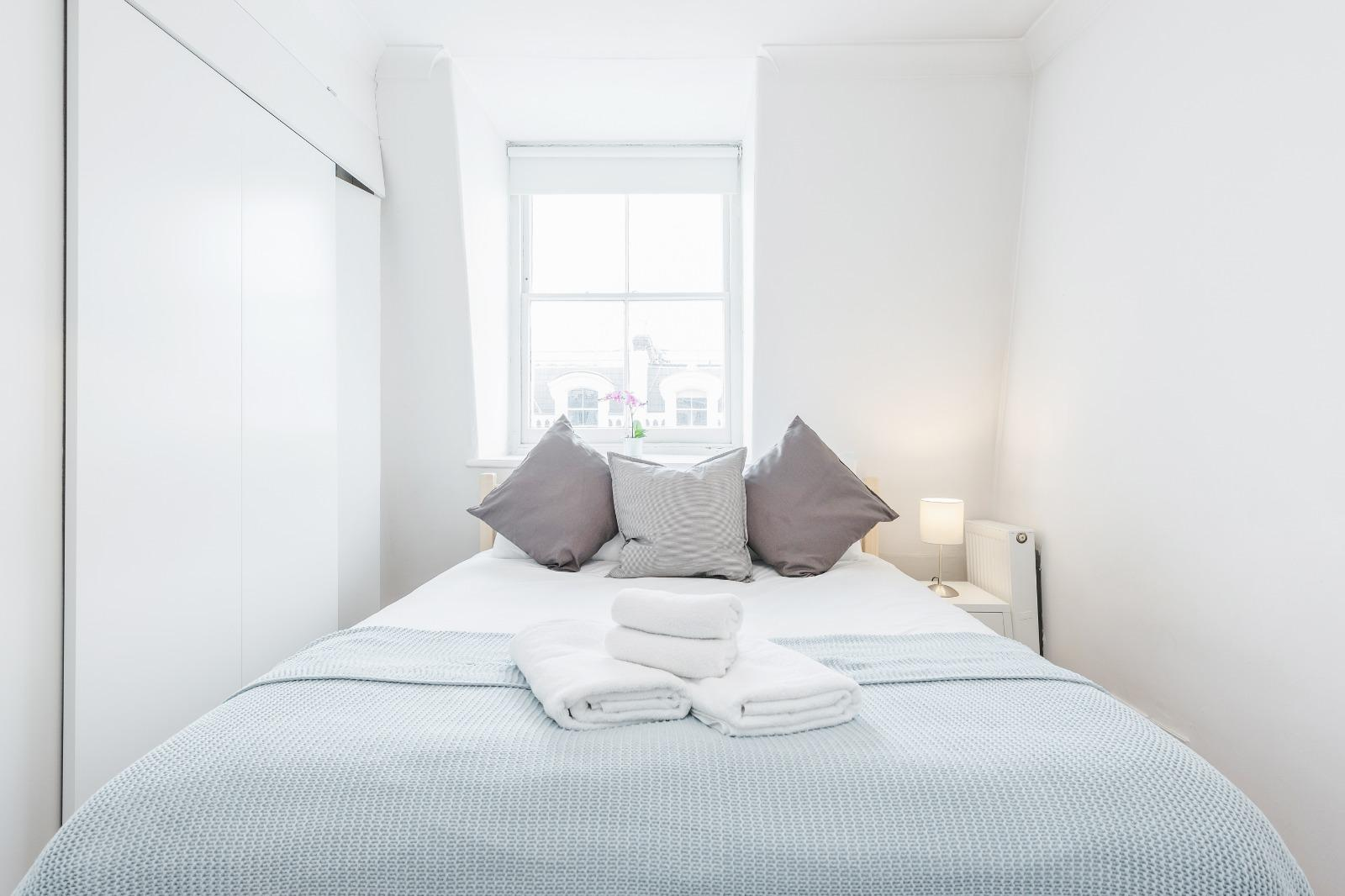Bedroom at Clanricarde Gardens Apartment, Bayswater, London - Citybase Apartments