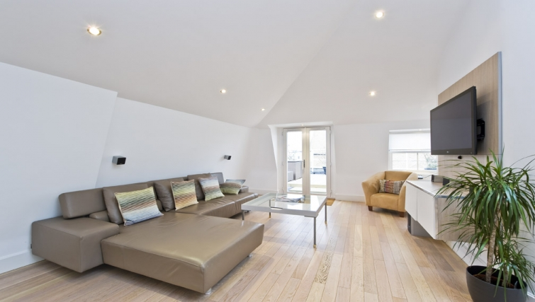 Modern living area in Nevern Place Aparthotel - Citybase Apartments