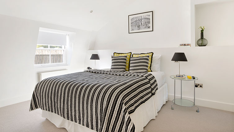 Bright bedroom at Nevern Place Aparthotel - Citybase Apartments